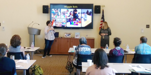 Youth services staff members learn about STEM programming at event